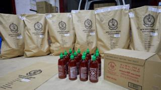 New South Wales police force picture of sriracha chilli sauce bottles carrying hundreds of kilograms of crystal meth