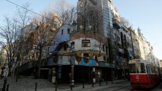 "The Hundertwasser House landmark, an apartment house designed by artist and architect Friedensreich Hundertwasser, with the ""Terrassencafe im Hundertwasserhaus"" is seen in Vienna"