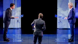 Dutch Prime Minister Mark Rutte (L) of the Liberal Party (VVD) and the right-wing Freedom Party (PVV) leader Geert Wilders (R) face each other during a TV debate