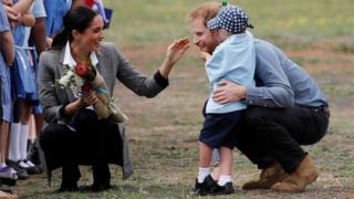 OCTOBER 17 Harry and Meghan speak to five year old Luke Vincent during their Royal tour of Australia