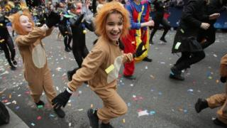 "People take part in the London New Year""s Day Parade."
