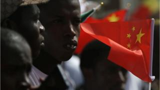 Well wishers holding flags wait for the arrival of Chinese President Xi Jinping at the Leopold Sedar Senghor International Airport at the start of his visit to Dakar, Senegal July 21, 2018.