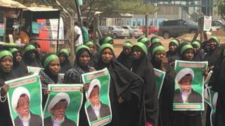 IMN members wit dia placards