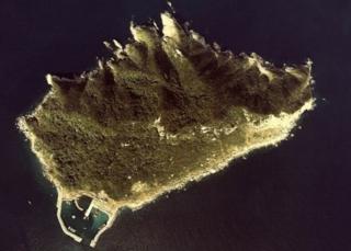 ภาพถ่ายทางอากาศของเกาะโอกิโนะชิมะ ซึ่งจะได้รับการขึ้นทะเบียนเป็นมรดกโลกในเดือน ก.ค. นี้