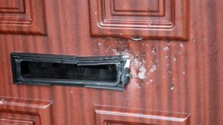 The shots caused damage to a door of the house in Dill Avenue