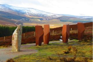 The Watchers standing sentinel to the east of The Lecht with the snow capped Cairngorms in the background.