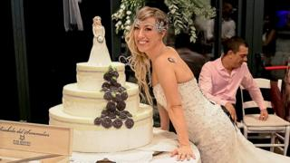 Laura Mesi, who married herself, with her wedding cake