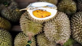 Durian fruits are displayed at a roadside shop in Karak, in the suburbs of Pahang outside Kuala Lumpur on 14 July 2015.