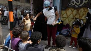 Children wait for food rations in Yemen