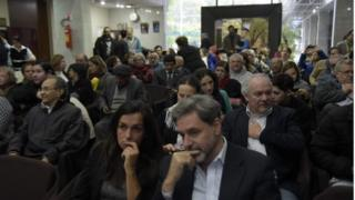 """Relatives and victims of Argentine and Paraguayan militar dictatorships hear the sentence of Argentina""""s court in the trial on Operation Condor, at the Argentina""""s embassy in Asuncion on 27 May 2016"""