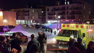An ambulance is parked at the scene of a fatal shooting at the Quebec Islamic Cultural Centre in Quebec City, Canada January 29, 2017.