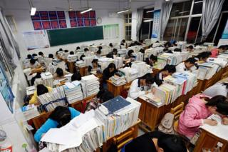 This photo taken on 24 May 2016 shows senior high school students studying at night to prepare for the college entrance exams at a high school in Lianyungang, east China's Jiangsu province.