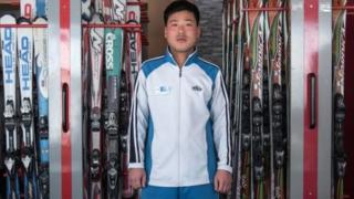 In this photo taken on February 20, 2017, Kim Chol-Nam, 30, poses for a portrait at the ski hire desk