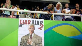 Poster calling Lochte a liar in Rio stadium