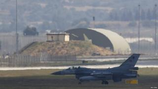 A Turkish fighter jet lands at Incirlik air base