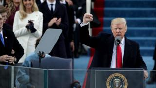 Trump raises fist at inauguration