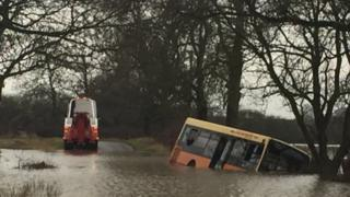 School bus trapped in flood water north of York