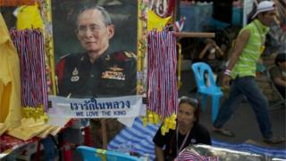 A portrait of revered Thai King Bhumibol Adulyadej is displayed at a kiosk selling souvenirs in a central part of the city being occupied by anti-government protesters December 4, 2013 in Bangkok, Thailand.