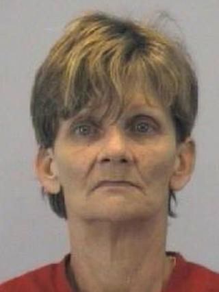 The Goldsboro Police Department provides an image of Marcia Jean Lee, who was arrested on charges of failure to report a death after her mum's body was found inside a reezer sold at a yard sale.