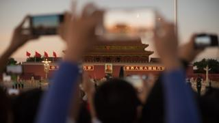 Smartphones in front of Beijing's Forbidden City