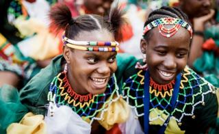 Young traditionally clad Zulu maidens arrive at The Moses Mabhida Football Stadium in Durban on 7 October 2018.