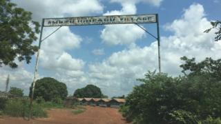 Entrance to Izzi community