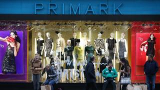 Pedestrians in front of Primark shop