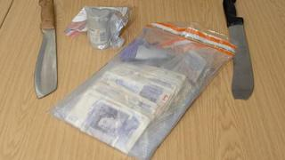 Recovered machetes, cash and drugs