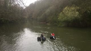 Coracle fishermen on the river