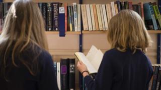 School girls reading books