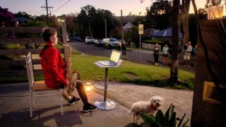 in_pictures Jude Fell, aged 10, plays The Last Post on a saxophone from his driveway at dawn in Sydney on April 25, 2020