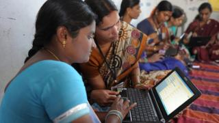 Indian women working on a laptop.