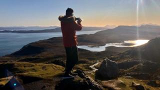 A man on top of the Storr in Skye
