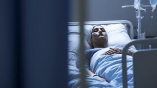 Woman receiving cancer treatment