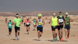 runners against a dark sky
