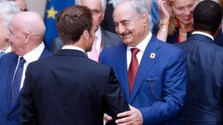 Khalifa Haftar shaking hands with President Macron in Paris