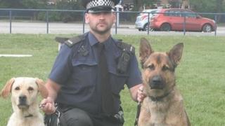 Con Dave Bartley with Ghost (right) and his second police dog Lucy