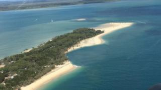 Aerial shot of Inskip Point with the missing beach section