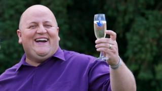 Adrian Bayford celebrates his lottery win