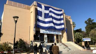"Banner at the municipal theatre on the Greek island of Lesbos reads: ""We want our islands back, we want our lives back."""