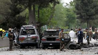 Afghan security forces inspect the site of a suicide attack in Kabul