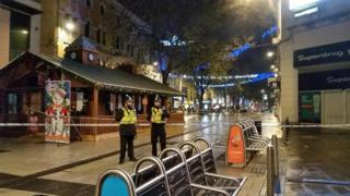 Police standing outside a cordoned off area of Queen St