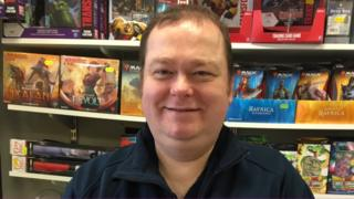 Paul Thomas in his comic and games shop
