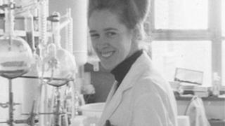 Black and white photo of Jean Purdy in a laboratory