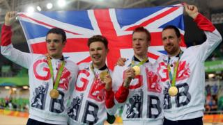 Owain Doull, Edward Clancy, Steven Burke and Bradley Wiggins with gold medals