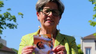 Viviane Lambert, the mother of Vincent Lambert, poses with a photograph of him in hospital