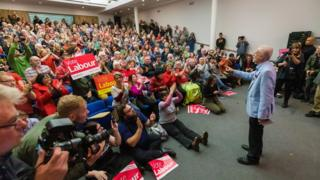 "Britain""s Opposition Labour Party Leader Jeremy Corbyn (C) delivers a speech at a member mobilisation rally and local campaign launch (climate crisis and Green Industrial Revolution) event at the University of Gloucester in Gloucester,"