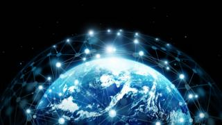 Graphic showing the Earth surrounded by a communications network