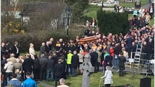 Mourners paying their respects to 'Big Tom' after his funeral in County Monaghan on Friday morning