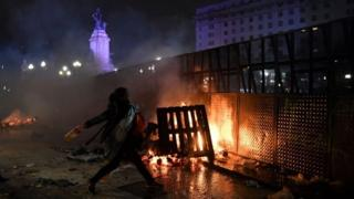 A protester hurls a missile outside Argentina's parliament